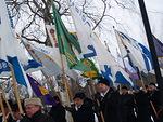Floorankentän kaunista vihreäpohjaista lippua kantoi presidentti Simo Pääkkönen.